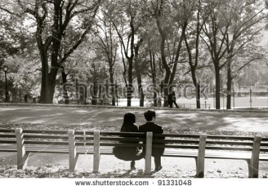 stock-photo-couple-sitting-at-park-bench-91331048
