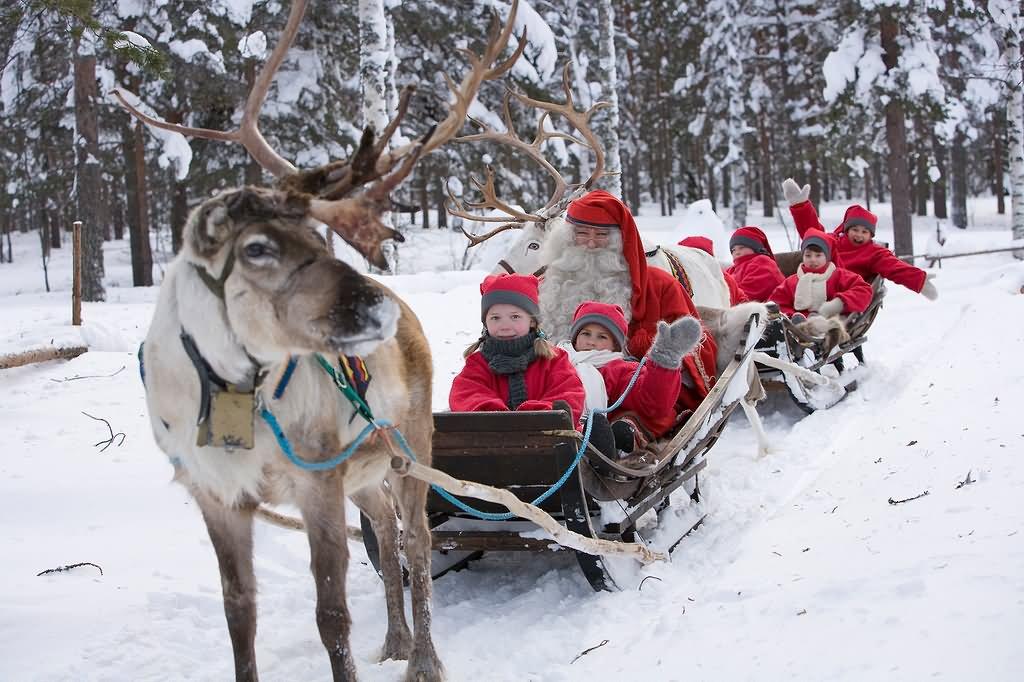 Kids-Enjoying-With-Santa-And-Elfs-Reindeer-Sled-At-The-Santa-Claus-Village