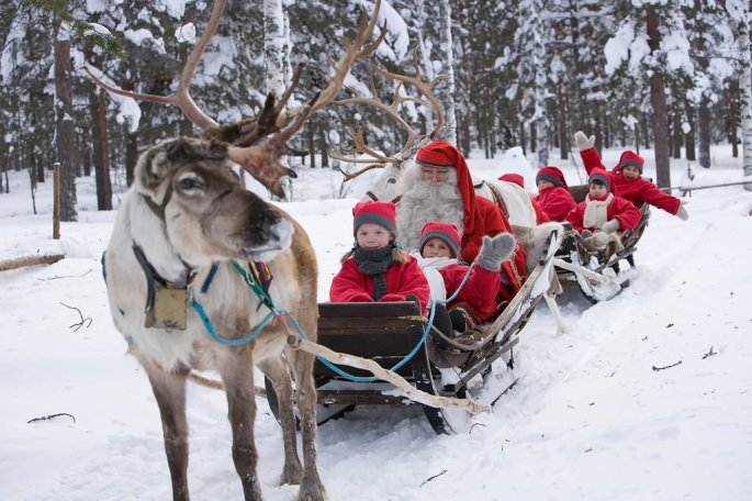 Kids-Enjoying-With-Santa-And-Elfs-Reindeer-Sled-At-The-Santa-Claus-Village